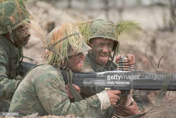 Soldiers from the 82nd Airborne Division open fire with their machine gun during the Grenada invasion | Location Grenada