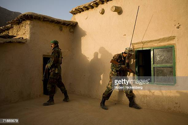 Soldiers from the Afghan National Army search a house for weapons in the village of Maydan Kalay north of Qalat, Zabul Province September 12, 2006....
