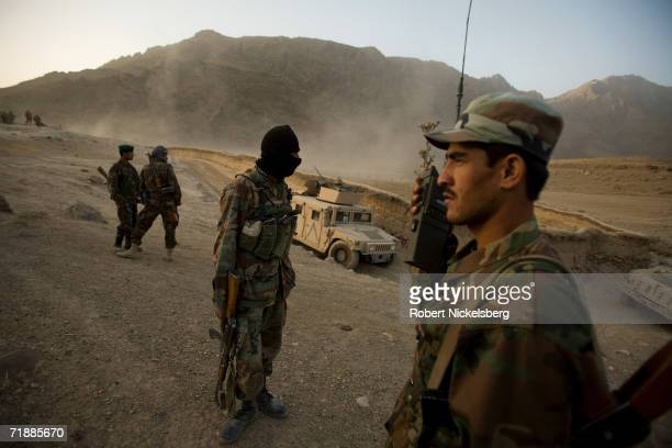 Soldiers from the Afghan National Army set up a check point outside the village of Maydan Kalay north of Qalat Zabul Province September 12 2006 The...