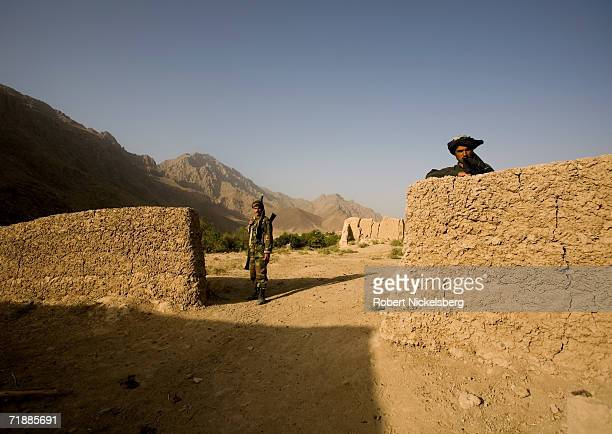 Soldiers from the Afghan National Army set up security posts outside the village of Maydan Kalay north of Qalat, Zabul Province September 12, 2006....