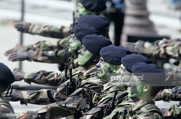 Soldiers from the Air Infantry and commando march down the ChampsElysees during the annual Bastille day parade on July 14 2011 in Paris France The...