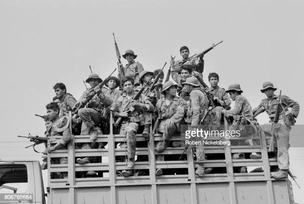 Soldiers from the Atlacatl Battalion advance during a military operation pursuing guerrillas from the Farabundo Martí National Liberation Front in...
