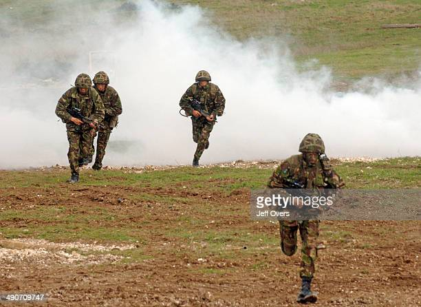 Soldiers from the British Army take part in a training exercise on Salisbury Plain Wiltshire Troops infantry smoke