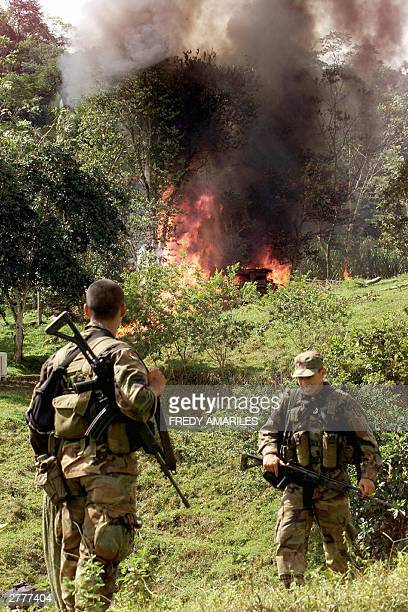 Soldiers from the Colombian IV Infantry Brigade burn a clandestine cocaine-processing laboratory, 02 December, 2003 in San Carlos, department of...