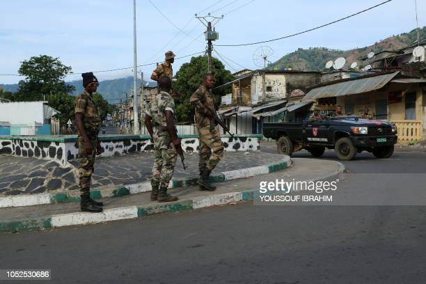 Soldiers from the Comoros armed forces station and wait outside the Medina at Mutsamudu on October 19 2018 in Anjouan Comoros The Comoros government...