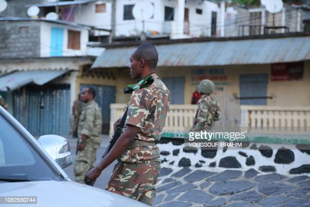 Soldiers from the Comoros armed forces station and wait outside the 'Medina' at Mutsamudu on October 19 2018 in Anjouan Comoros The Comoros...