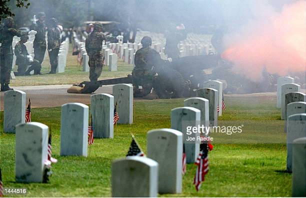 Soldiers from the Delta Battery 11th Brigade Fort Bliss Texas fire WW II era 75mm howitzers among the grave stones during the 21 gun salute at Fort...