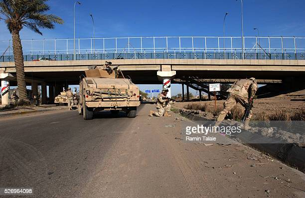 US soldiers from the Fighting 69 a New York National Guard unit shut down Route Irish the highway between Baghdad International Airport and central...
