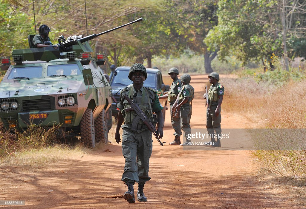 Soldiers from the FOMAC multinational force of central African states man a position near Damara between the 'red line' separating regular army soldiers of the Central African Republic and rebels f...