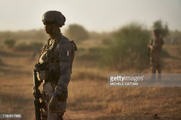 Soldiers from the French Army in Sahel monitor a rural area during the Bourgou IV operation in northern Burkina Faso along the border with Mali and...