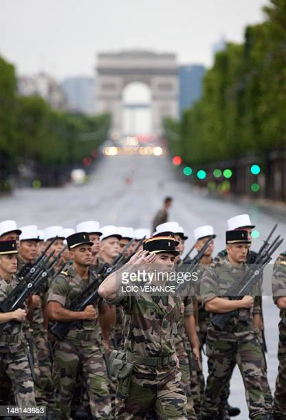 Soldiers from the French Foreign Legion parade on the ChampsElysees avenue on July 11 2012 in Paris during a rehearsal of the military parade as part...