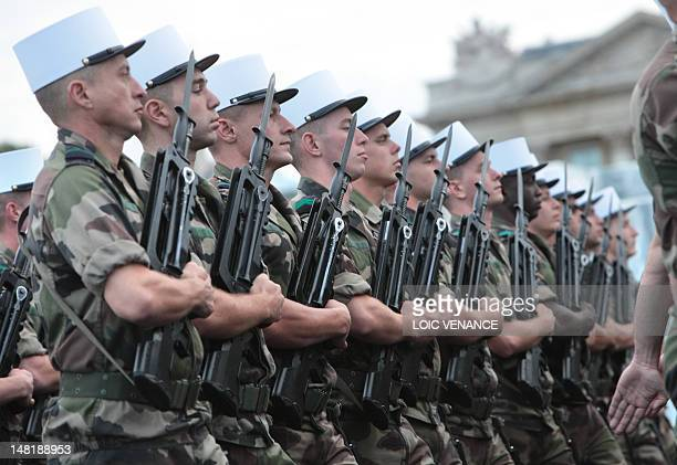 Soldiers from the French Foreign Legion parade on the ChampsElysees avenue on July 12 2012 in Paris during a rehearsal of the military demonstration...