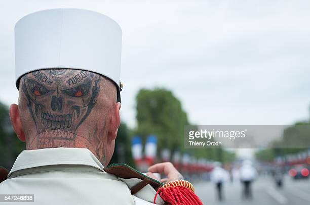 Soldiers from the French Foreign Legion with Tatoo Loyalty and HonorÊ On Champs Elysees for Bastille Day military parade in Paris on July 14 2016in...