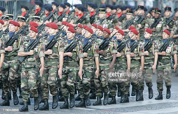 Soldiers from the French overseas territories military units march the ChampsElysees during the annual Bastille day parade on July 14 2011 in Paris...