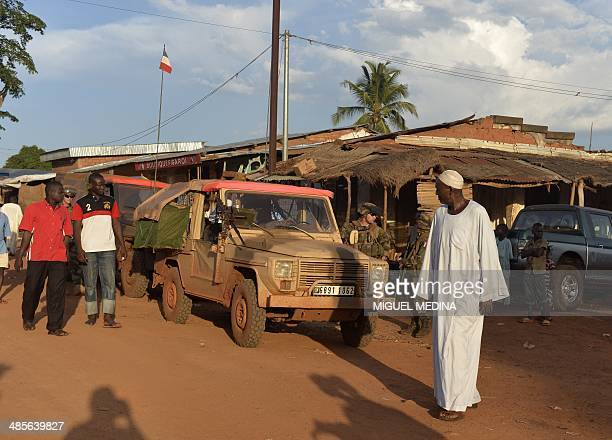 Soldiers from the French Sangaris forces are pictured during a patrol in the Muslim district of Bambari on April 19 2014 In the nightmare of the...