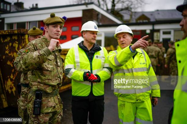 Soldiers from The Highlanders 4th Battalion The Royal Regiment of Scotland help to shore up flood defences as Storm Dennis begins to make landfall in...