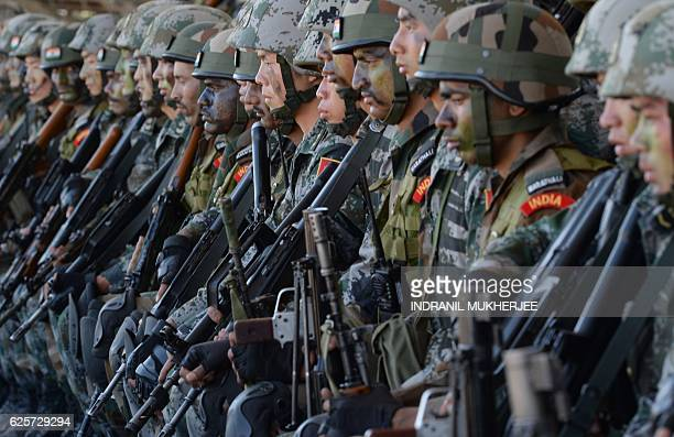 Soldiers from the Indian Army and People's Liberation Army sit together after participating in an antiterror drill during the Sixth IndiaChina Joint...