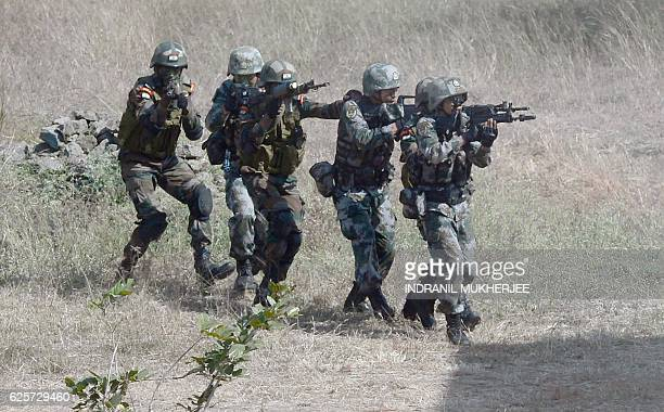 Soldiers from the Indian Army and the People's Liberation Army of China participate in an antiterror drill during the Sixth IndiaChina Joint Training...