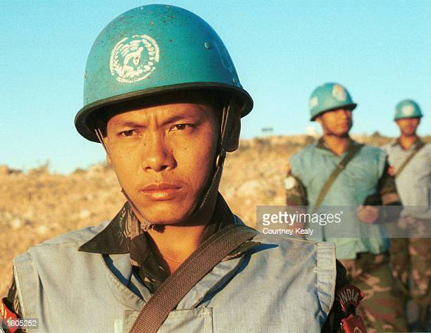 Soldiers from the Indian Battalian of the United Nations Peacekeeping Force of Lebanon patrol along the border with Israel and Syria in an effort to...