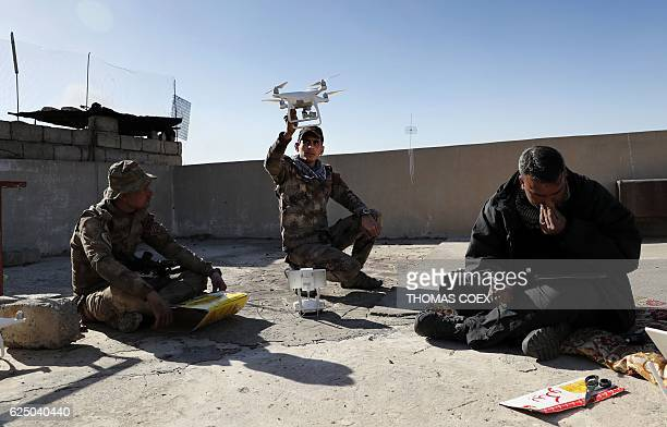 Soldiers from the Iraqi Special Forces fly a small drone from a roof to look for Islamic State group fighters hiding themselves in the Aden district...