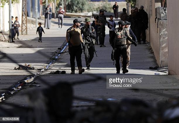 Soldiers from the Iraqi Special Forces patrol a street in the Aden district of Mosul after troops almost entirely retook the area from Islamic State...