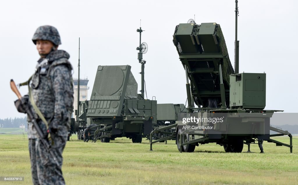 Soldiers from the Japan Air Self-Defense Force set up PAC-3 surface-to-air missile launch systems during a temporary deployment drill at US Yokota Air Bace in Tokyo on August 29, 2017. Some 50 Japanese servicemen took part in the drill. / AFP PHOTO / Toru YAMANAKA