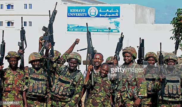 Soldiers from the Kenyan Contingent of the African Union Mission in Somalia celebrate in the Somali port city of Kismayo on October 2 2012 Blasts...