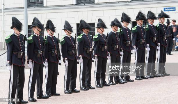 Soldiers from the King's Guards taking part in the daily changing of the guard at The Royal Palace on August 1 2017 in Oslo Norway Thousands of...
