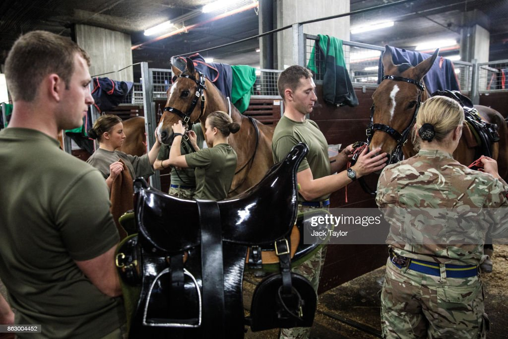 Soldiers from the King's Troop Royal Horse Artillery prepare at Wellington Barracks ahead of their 70th anniversary parade on October 19, 2017 in London, England. Queen Elizabeth II will review the King's Troop Royal Horse Artillery to mark the 70th anniversary in Hyde Park today. 'The Troop' is a ceremonial mounted unit made up of 111 horses and a number of First World War state saluting guns which are fired during Royal Anniversaries and State Occasions.