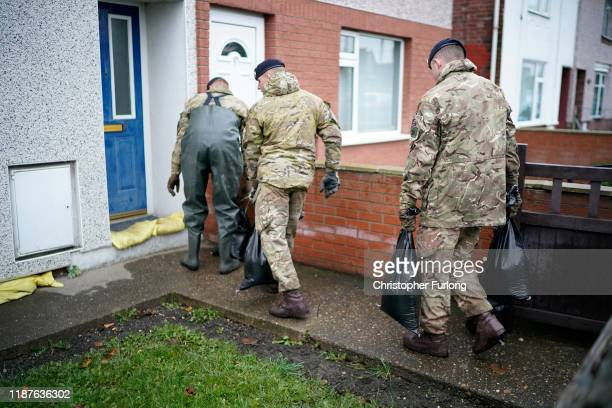 Soldiers from the Light Dragoons sandbag the homes of residents in Bentley as residents start to salvage belongings from their homes and businesses...