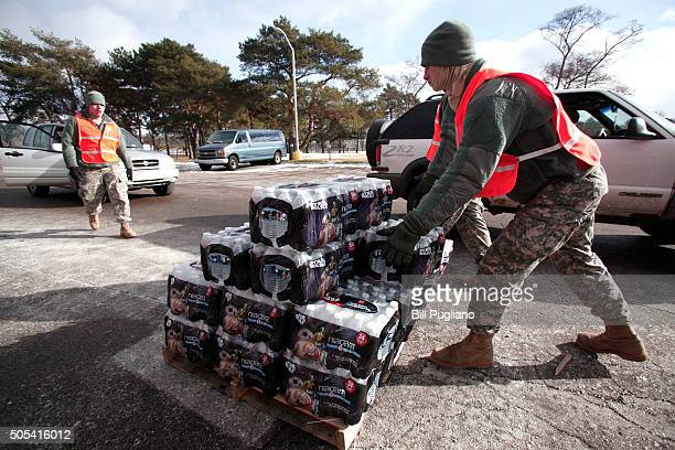 Soldiers from the Michigan Army National Guard Flint prepare to give Flint residents bottled water at a fire station January 17 2016 in Flint...