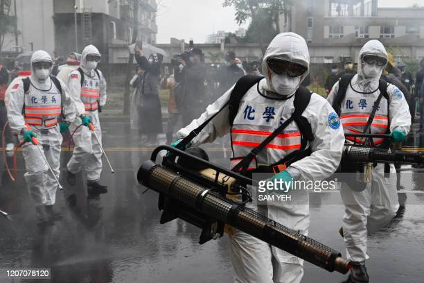 Soldiers from the militarys chemical units take part in a drill organised by the New Taipei City government to prevent the spread of the COVID-19...