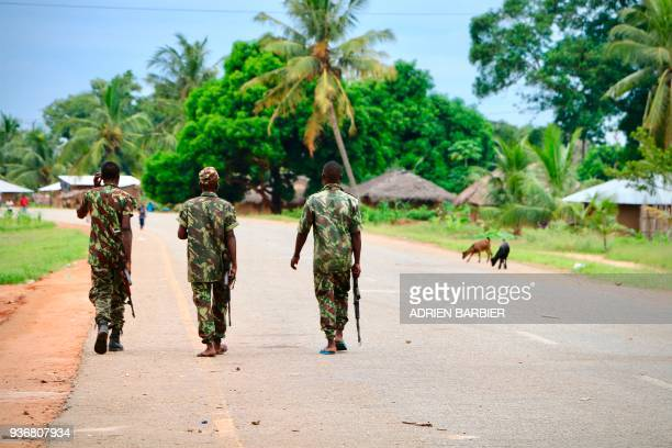 Soldiers from the Mozambican army patrol the streets after security in the area was increased following a twoday attack from suspected islamists in...