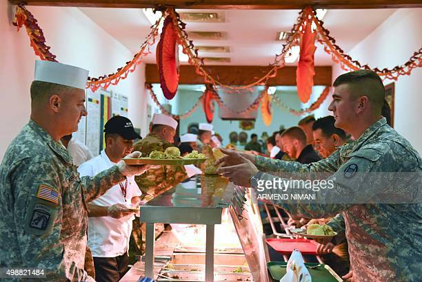 US soldiers from the NATO ledpeacekeeping mission in Kosovo take part in a traditional Thanksgiving meal at the US military base Camp Bondsteel near...