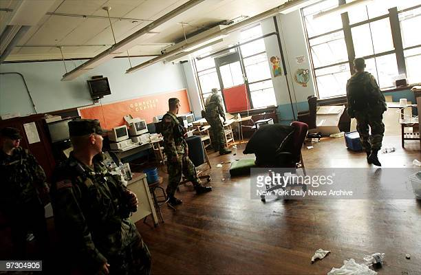 Soldiers from the Oregon National Guard walk through a public school in the 9th Ward neighborhood of New Orleans looking for survivors and bodies in...