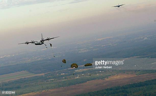 Soldiers from The Parachute Regiment prepare to jump on to Ginkel Heath Near Arnhem to help celebrate the 60TH Anniversary of Operation Market...