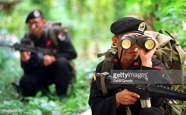 Soldiers from the Philippines'' elite Scout Rangers train February 20 2002 at the Scout Rangers camp in Isabela on the southern Philippine island of...