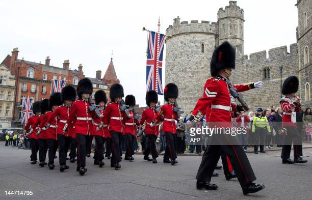Soldiers from the Queen's Guard prepare for the 'Changing of the Guard' ceremony at Windsor Castle west of London on May 18 as Britain's Queen...
