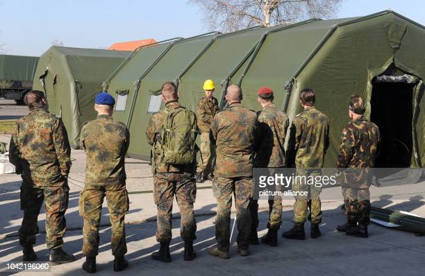 Soldiers from the rapid deployment medical services troups practice erecting medical tents in Leer Germany 05March 2013 The preparations are part of...