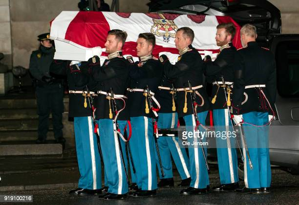 Soldiers from the Royal Guard carry the coffin of deceased Prince Henrik of Denmark into the Parliament's church on February 16 2018 in Copenhagen...
