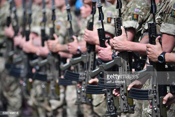 Soldiers from The Royal Highland Fusiliers 2nd Battalion The Royal Regiment of Scotland parade through the town on June 8 2016 in Ayr Scotland The...