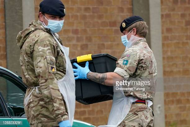 Soldiers from the Royal Logistics Corp operate a mobile coronavirus testing site at Evington Leisure Centre on June 29, 2020 in Leicester, England....