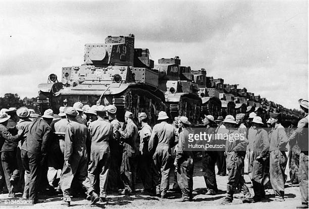 Soldiers from the Second Armoured Division at Fort Denning in Georgia remove the loading ramps from a train carrying a cargo of tanks to Tennessee...