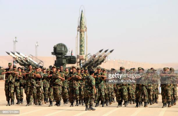 Soldiers from the selfstyled army of Libyan Strongman Khalifa Haftar take part in a military parade in the eastern city of Benghazi on May 7 during...