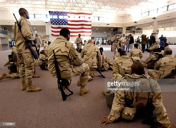 S soldiers from the Third Infantry Division listen to US Army Chaplin David Hall as they participate in a short prayer service at Hunter Army...