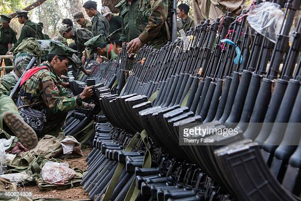 Soldiers from the TNLA get new AK47 rifles in a military camp The TNLA created in 2009 claims about 1500 soldiers and another 1500 trained villagers...