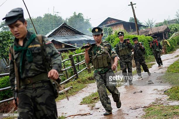 Soldiers from the TNLA patrol in a Palaung village The TNLA created in 2009 claims about 1500 soldiers and another 1500 trained villagers Alongside...