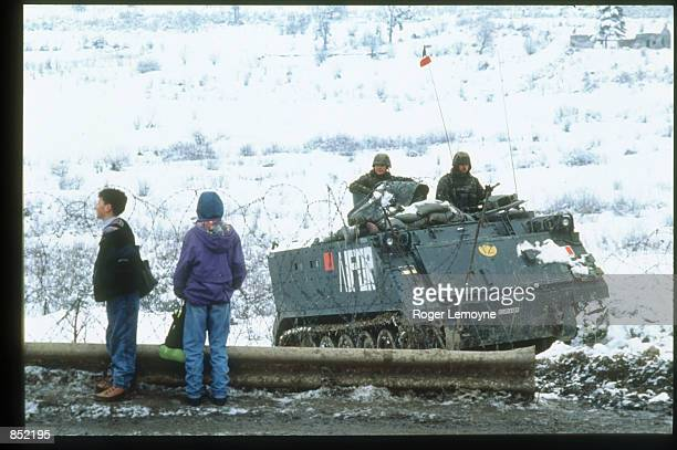 Soldiers from the United Nations Peacekeeping Force sit in a vehicle March 5, 1996 in Sarajevo, Bosnia-Herzegovina. The city is reopening its...