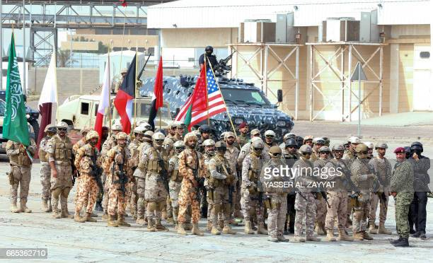 Soldiers from the United States Kuwait and other Gulf Cooperation Council countries participate in the concluding drill of the widescale Eagle...