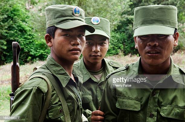 Soldiers from the United Wa State Army 171 Division stand in a village in the socalled Southern Wa State The 171 Division is run by the Chinese Wa...